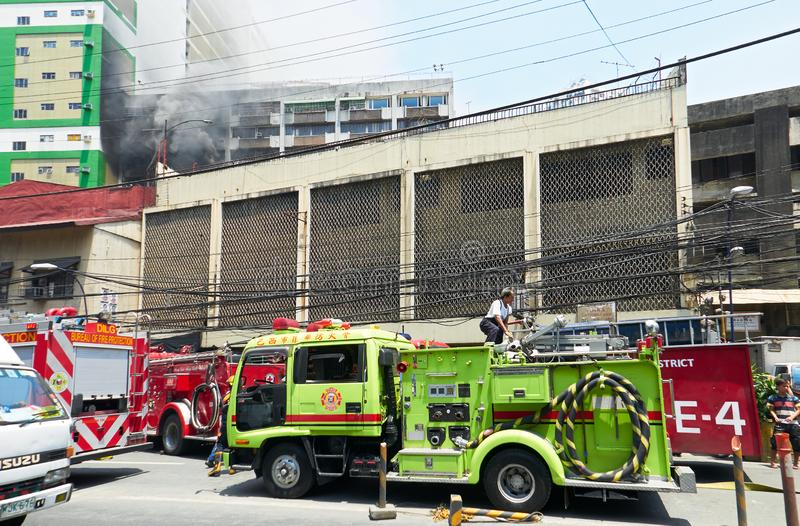 Several firetrucks with men at work in Manila, Philippines royalty free stock photo