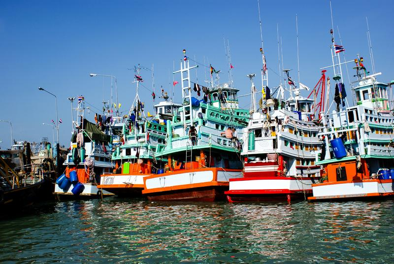 Several fishing ships moored in the port stock photos