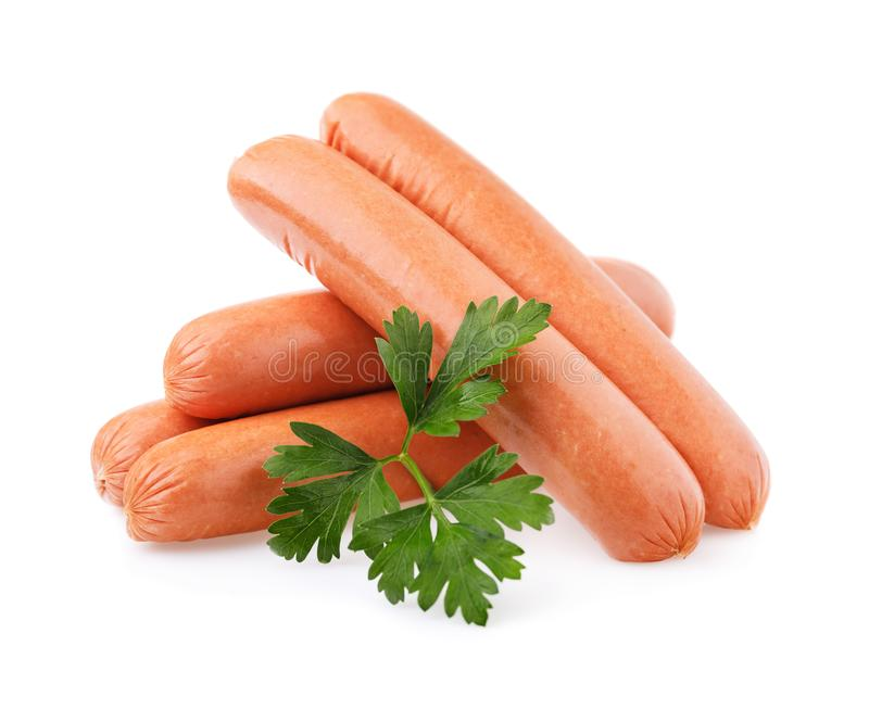 Several fresh sausages and sheet of fresh parsley isolated. On white background royalty free stock image