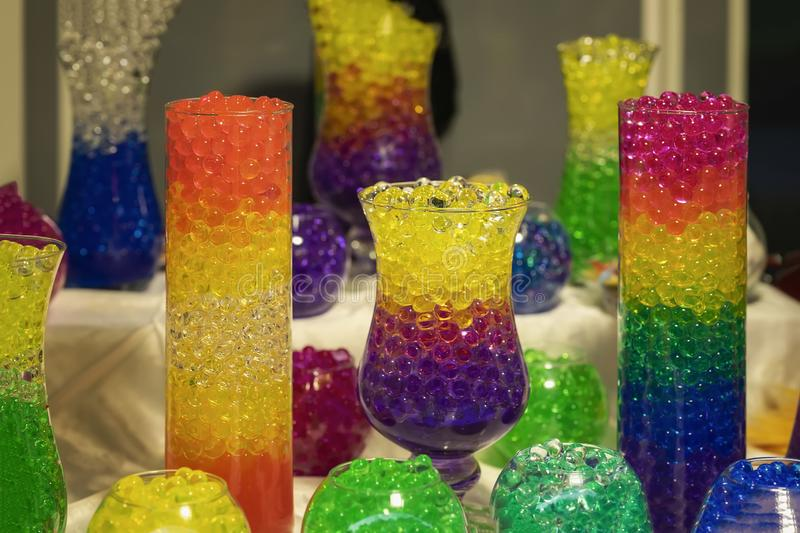 Several glass vases with a absorbent balls of hydrogel, bright colored colors royalty free stock images