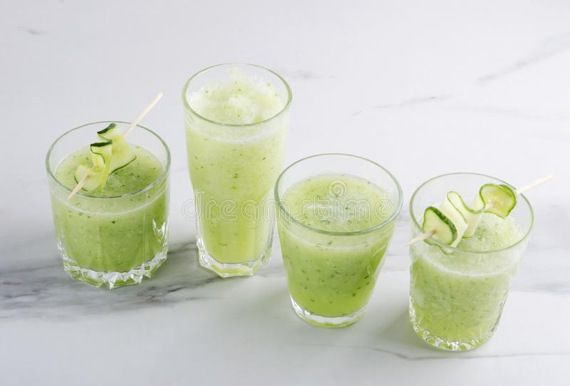 Several glasses of green organic smoothie.Organic and healthy drink royalty free stock photo