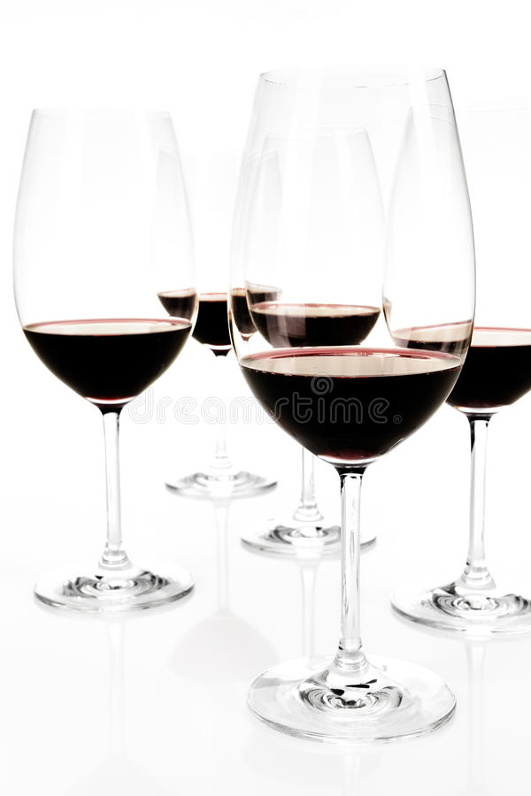 Several Glasses of red wine on white background