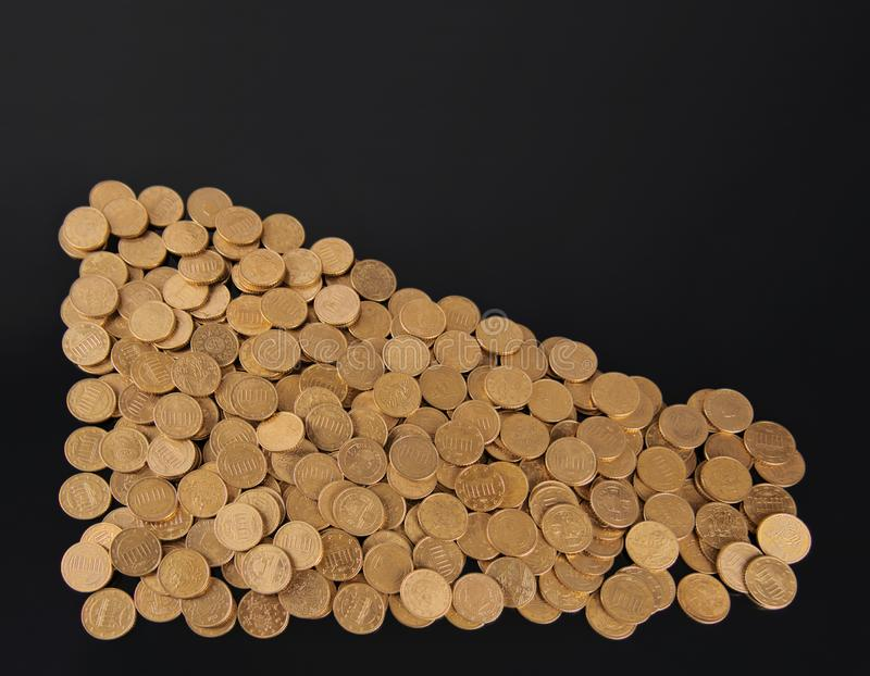 Several golden coins in the shape of a triangle stock images