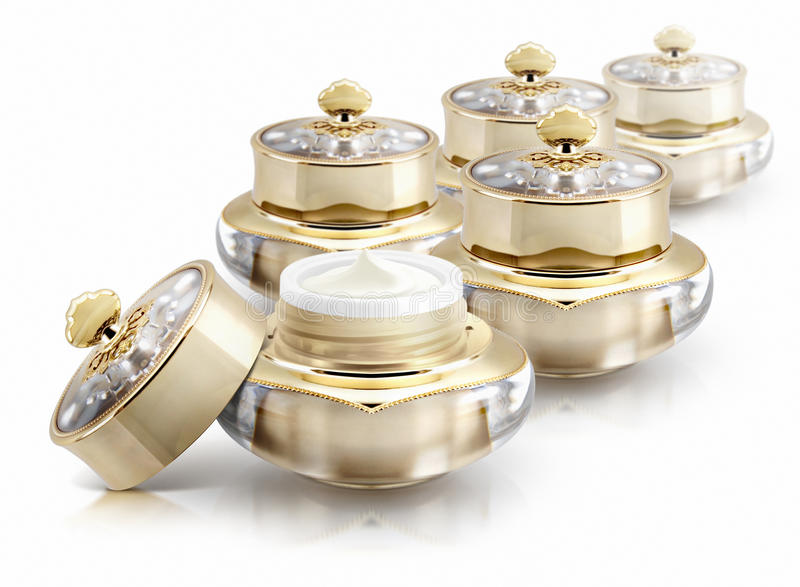 Several golden crown cosmetic jar on white. Background royalty free stock images
