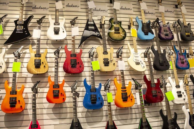 Several guitars at music store royalty free stock photos