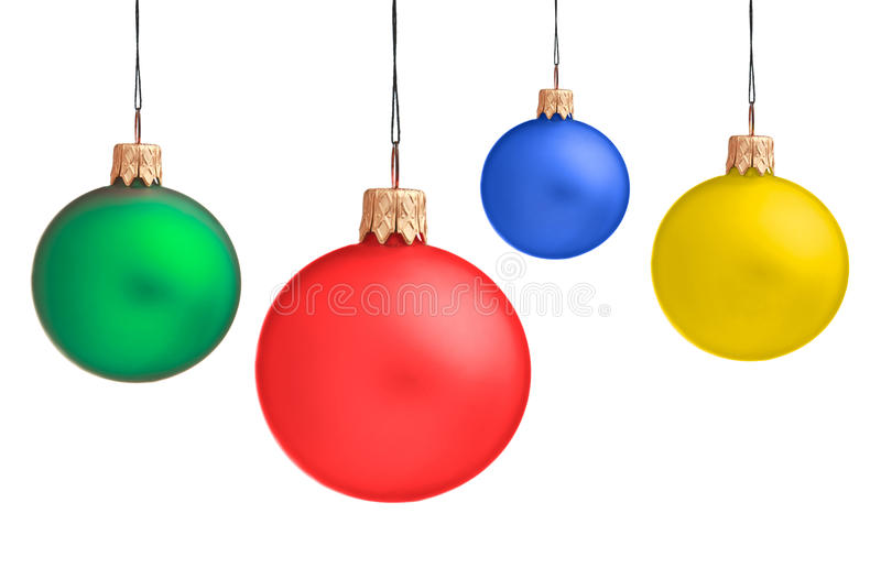 Several hanging Christmas baubles royalty free stock photos