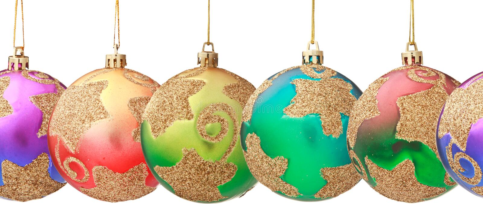 Several hanging Christmas baubles isolated royalty free stock photo