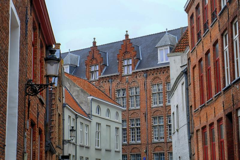 Several historical red houses in Bruges, Belgium. Historical houses in Bruges by day, Belgium stock image
