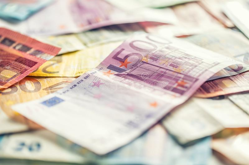 Several hundred euro banknotes stacked by value stock photos