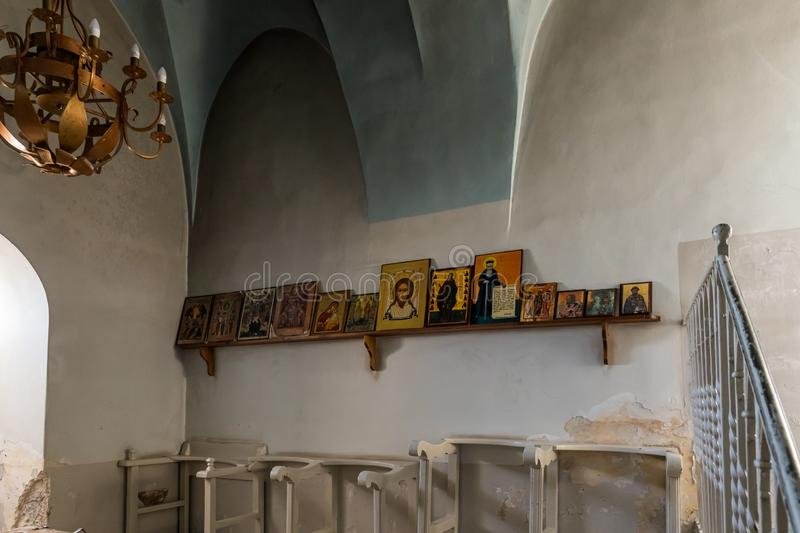 Several icons stand on a shelf in the St. Nicholas church dungeon in Bayt Jala - a suburb of Bethlehem in Palestine. Jerusalem, Israel, December 28, 2018 royalty free stock images