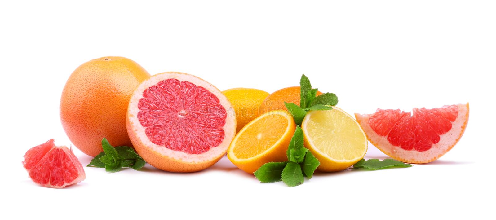 Several kinds of multi-colorful, whole and cut citrus fruits isolated on white background. Organic lemons, grapefruits and oranges. Perfect, ripe, juicy, fresh stock photo