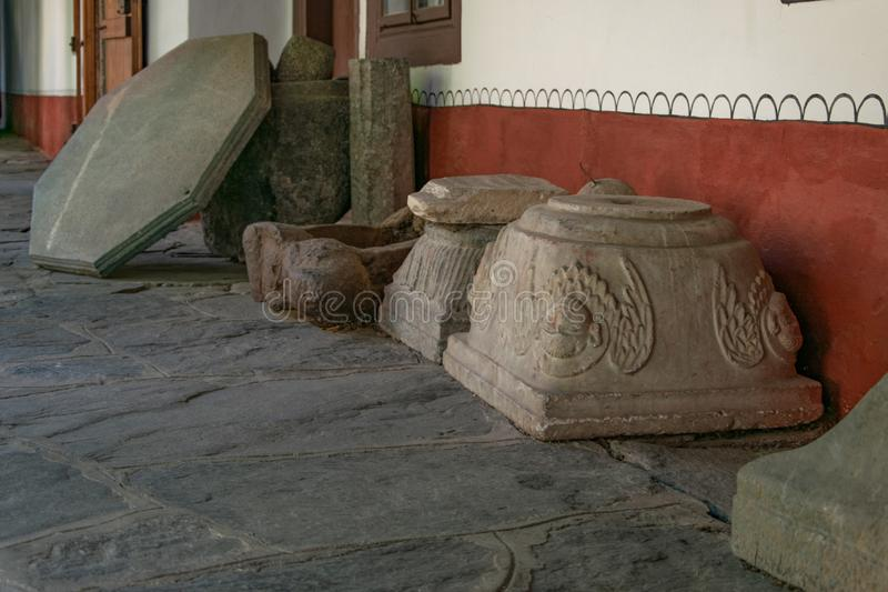 Several large pieces of carved stone, part of the architectural  monument. Ornaments stock image