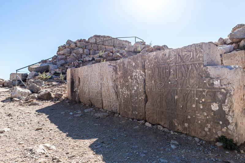 Several large stones with embossed inscriptions in Arabic in Nimrod Fortress located in Upper Galilee in northern Israel on the b stock images