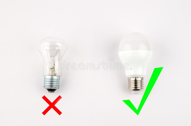 Several LED energy saving light bulbs over the old incandescent, use of economical and environmentally friendly light. Bulb concept, the choice of old or new royalty free stock photos