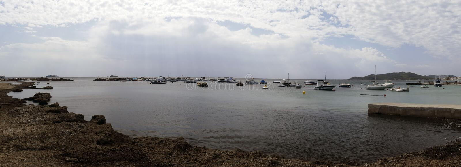 Several little boats are anchored of the coast royalty free stock images