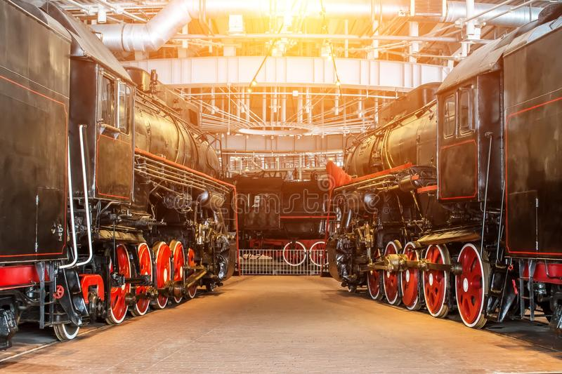 Several locomotives old steam vintage the railroad depot on repair maintenance service. royalty free stock photo
