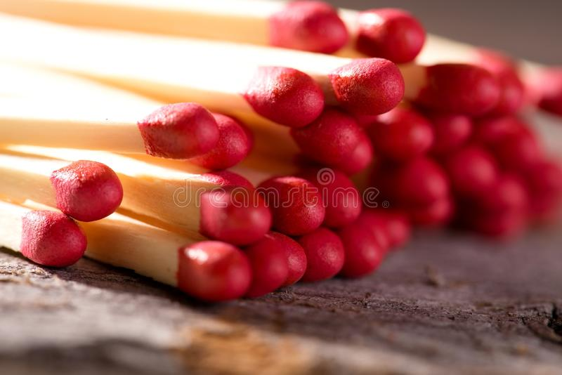 Several matchsticks with red heads stock photography