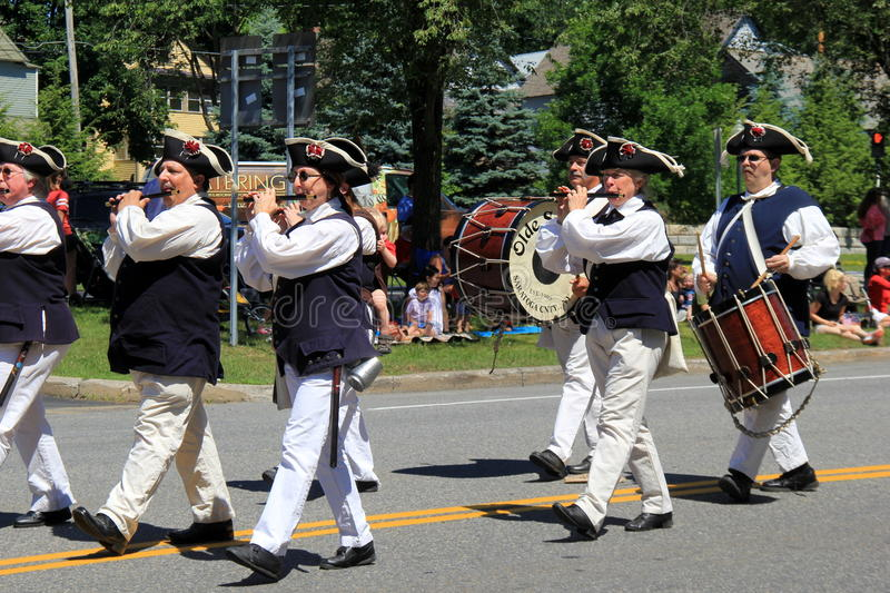 Several men in period costume, marching in July 4th parade, Saratoga Springs,New York,2016 stock image
