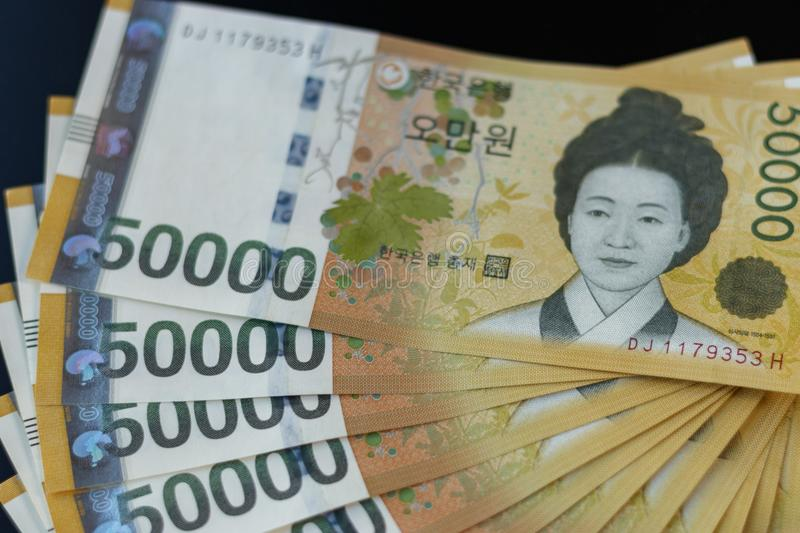 Several money notes of South Korea currency won. General image of South Korea Money, Won, which can be used as a concept for currency, finance, cash, e-commerce stock photo