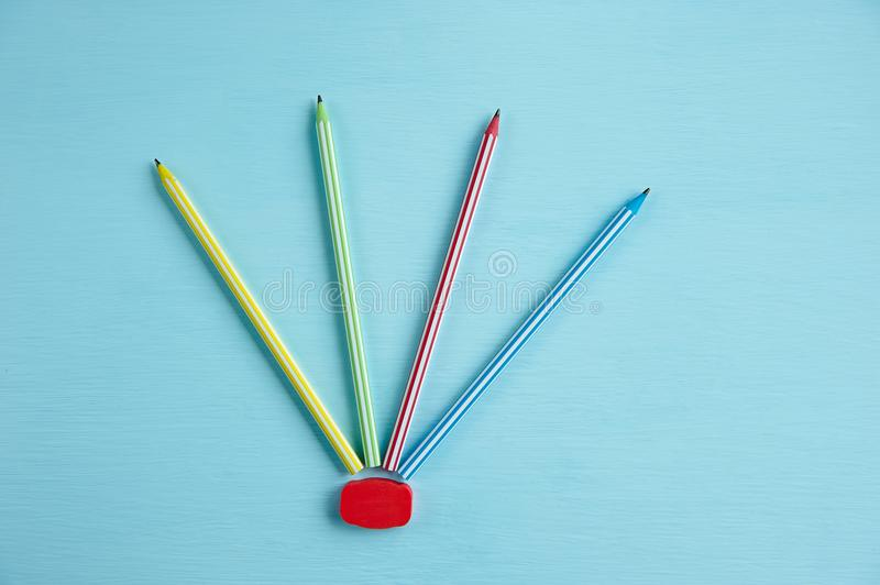 Several multicolored pencils on a blue background stock photography
