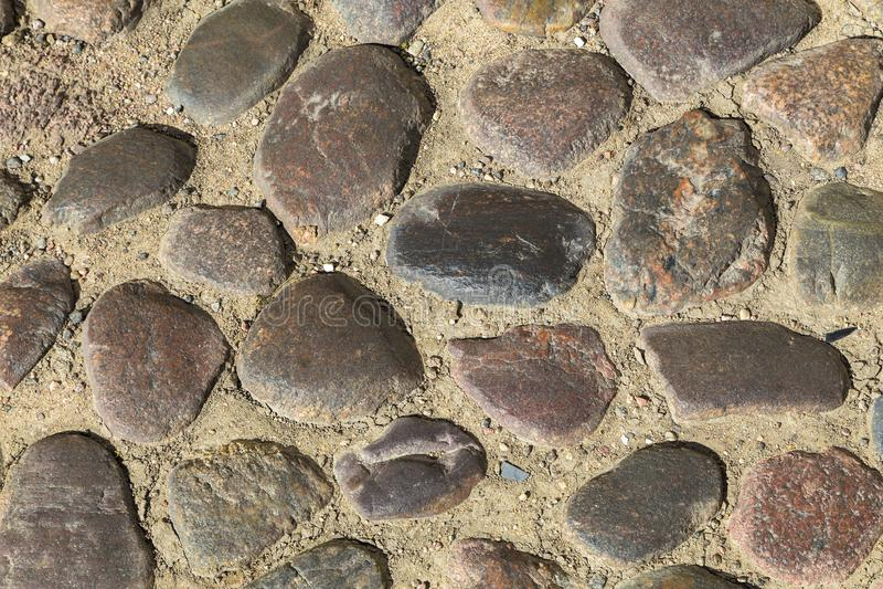 Multicolored stones in ground stock photo