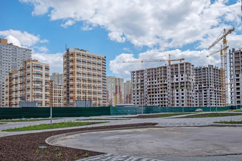 Several newly built and unfinished multi-storey houses in the new microdistrict.  royalty free stock photos