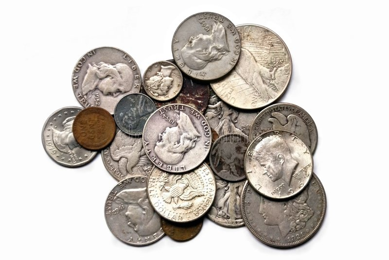 Several Old Coins. Stacked in a pile isolated on a white background. Includes: Wheat penny, Steel Penny, Franklin Half Dollar, Kennedy Half Dollar, Mercury Dime royalty free stock photos