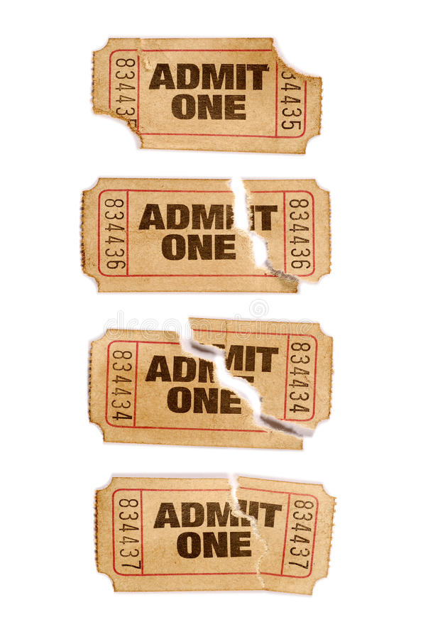 Several old torn and stained admit one movie tickets, white background, close up royalty free stock photography