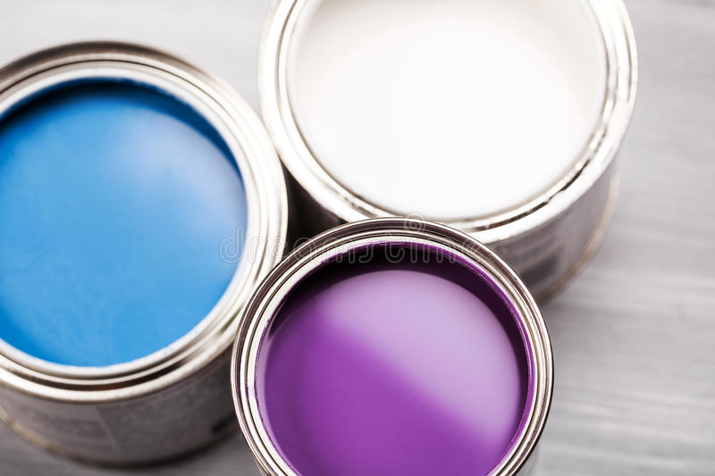 Several opened cans with paint inside. royalty free stock photos