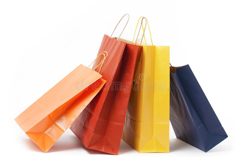Several Paper Bags. Several color paper bags on white background royalty free stock images