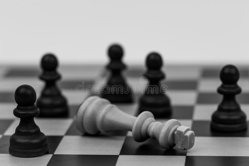 King in chess has fallen to several pawns royalty free stock photo