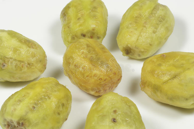 Several peeled prickly pears on white royalty free stock photos