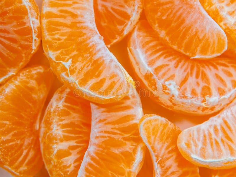 Several peeled ripe Mandarin slices, texture background stock photo