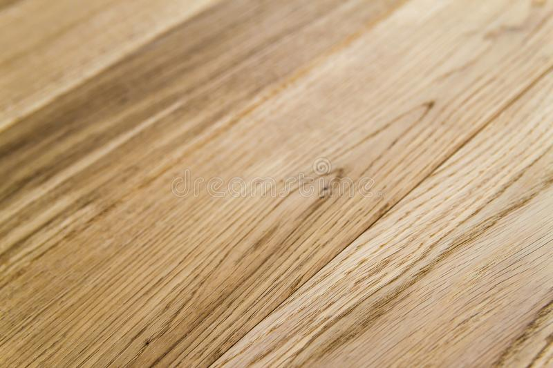 Several planks of beautiful laminate or parquet flooring with wooden texture as background stock photo