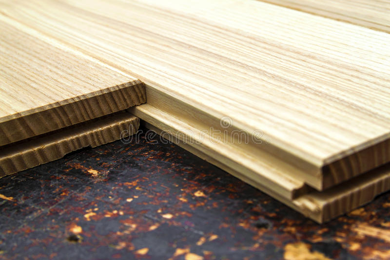 Several planks of beautiful laminate or parquet flooring with wooden texture as background royalty free stock photo
