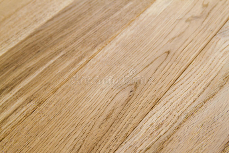 Several planks of beautiful laminate or parquet flooring with wooden texture as background royalty free stock photos