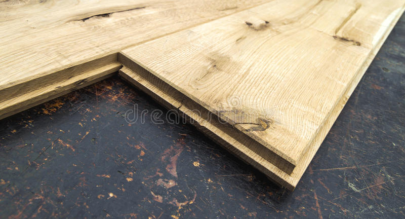 Several planks of beautiful laminate or parquet flooring with wooden texture as background royalty free stock image