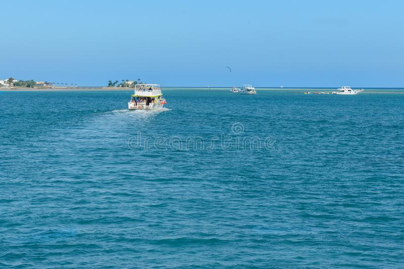 Several pleasure boats in the sea near the islands. boats in beautiful turquoise ocean near an island.  stock photos