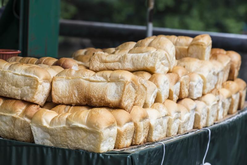 Several pounds of bread are available for sale. stock photography