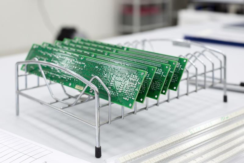 Several ready-made printed circuit boards are installed in a metal stand. royalty free stock photos