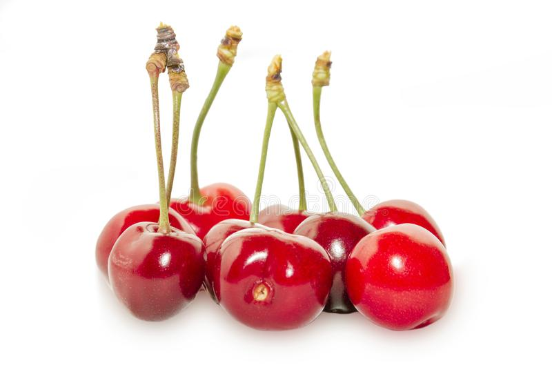 Several ripe cherries stock images