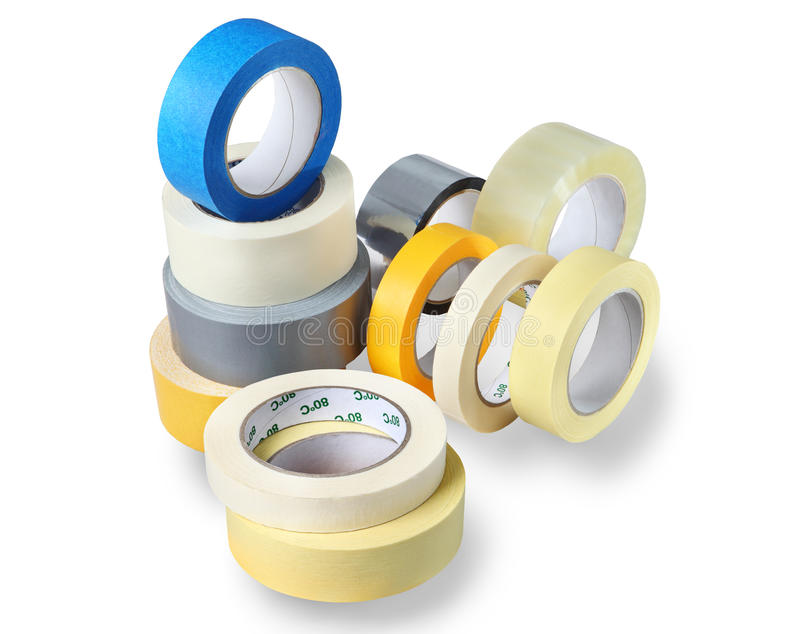 Several rolls of adhesive tapes of different colors, sizes, purposes. stock image