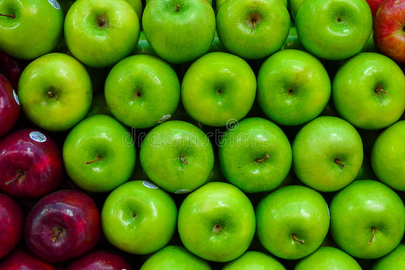 Green apples all on a row royalty free stock photo