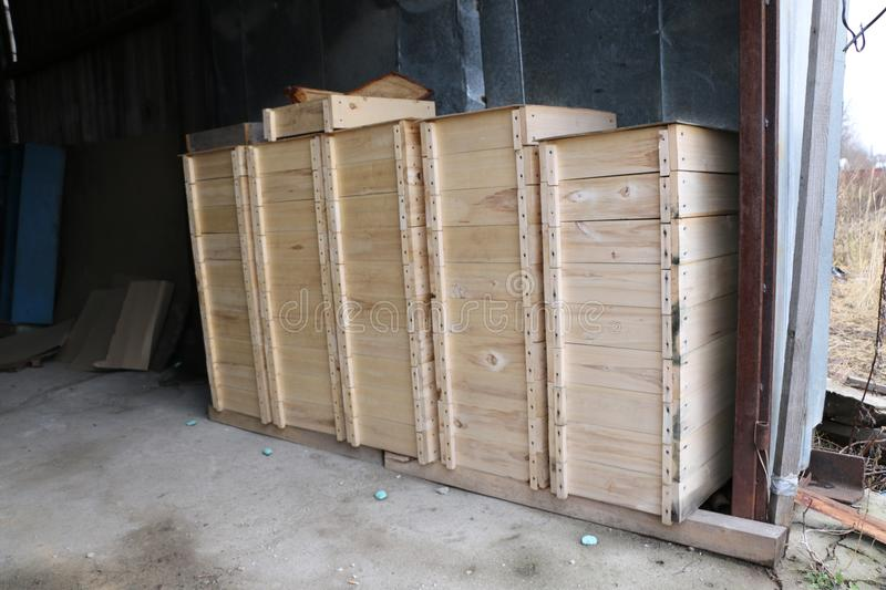 Wooden boxes for internal bee hives on a large apiary. Several rows of wooden boxes for the internal arrangement of bee hives on a large apiary royalty free stock images