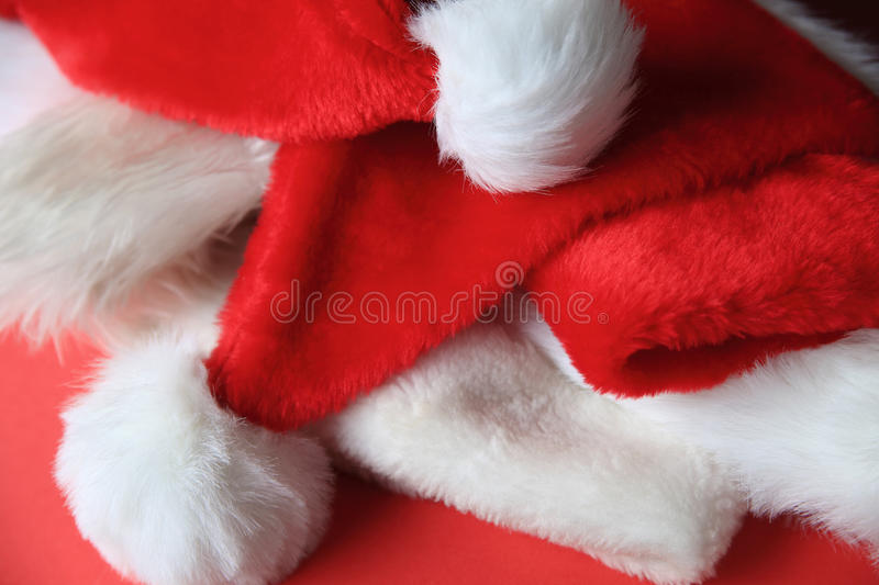 Several Santa Claus hats royalty free stock image
