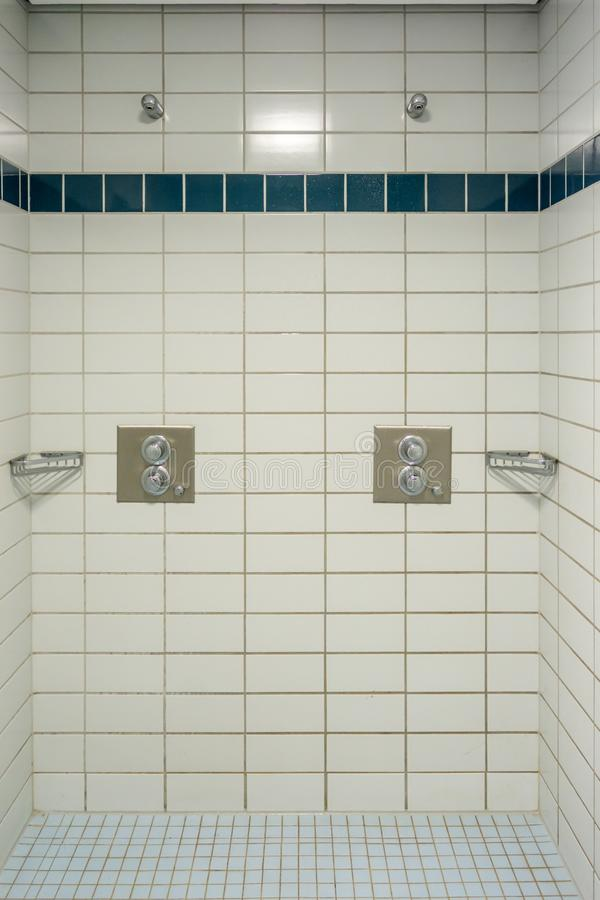 Several showers in a fully tiled shower room of a sports hall royalty free stock photo