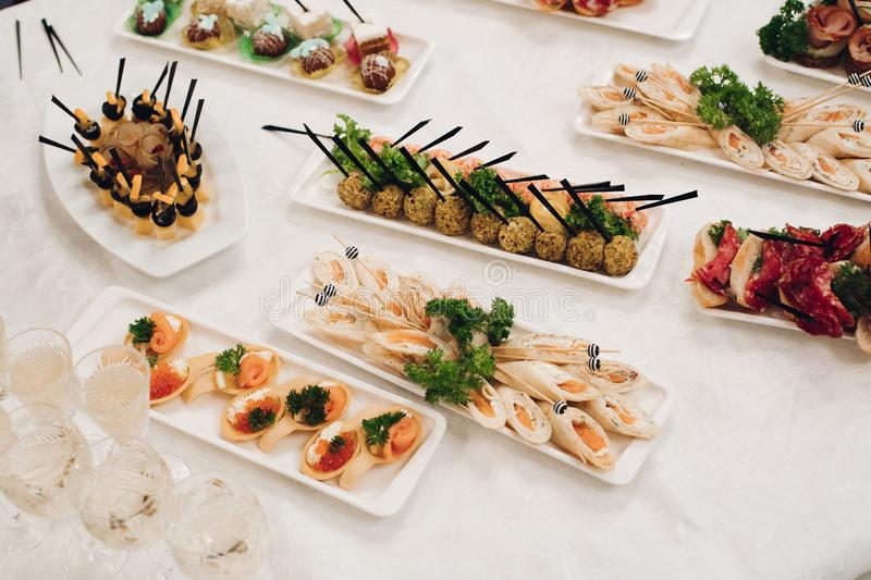 Several snacks served on birthday party or wedding celebration. royalty free stock photo