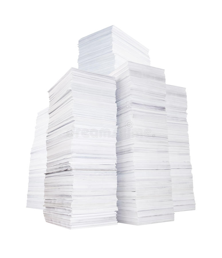 Several stacks of paper. Several high stacks of paper isolated on white background royalty free stock photos