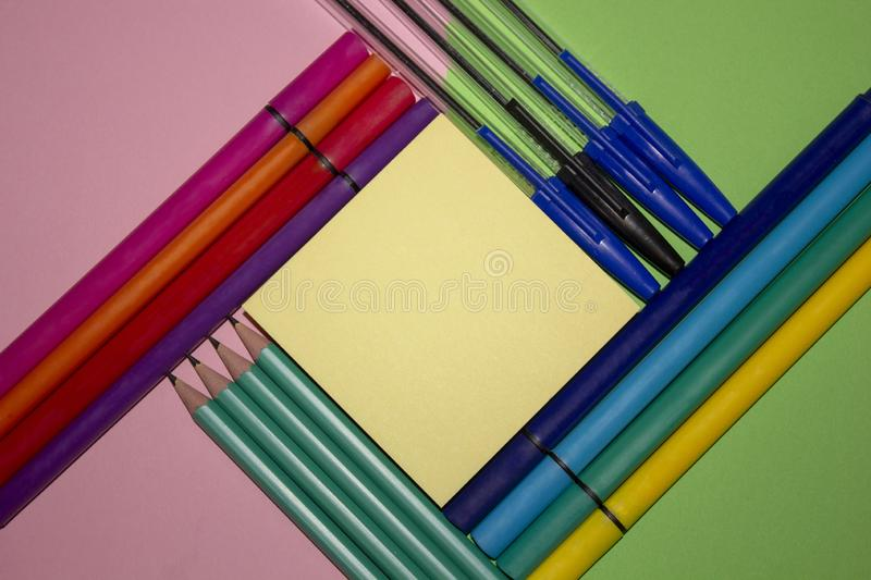 Several stationary supplies arranged in an aesthetically pleasing way. Pens, pencils, markers, note taking royalty free stock image
