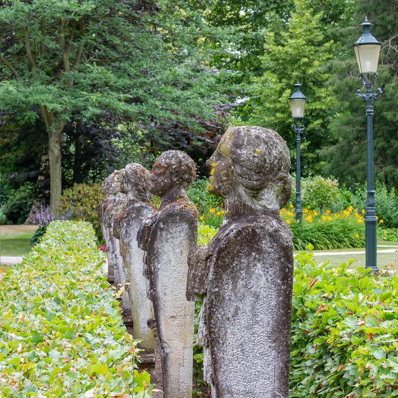 Several stone statues of persons on a row in a park of Bouvigne Castle at Breda, Netherlands royalty free stock photo